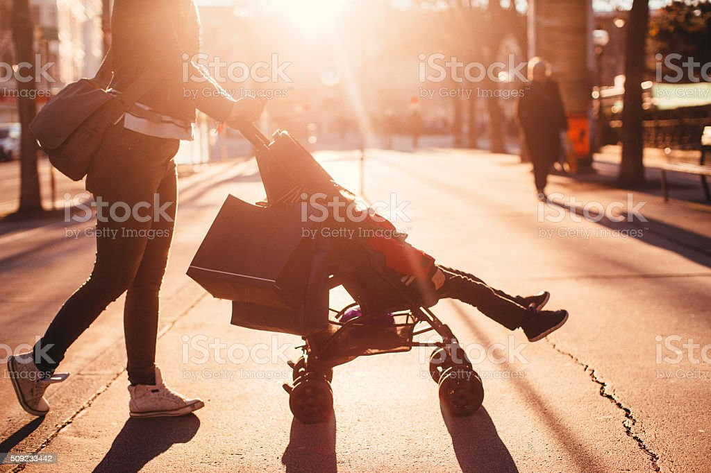 Urban mom with strollers stock photo