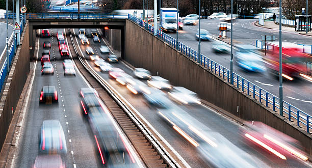 Urban motorway rush hour traffic in birmingham  multiple lane highway stock pictures, royalty-free photos & images