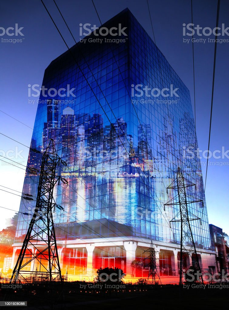 Urban Office Building at Sunset with Electric Pylons Silhouettes stock photo