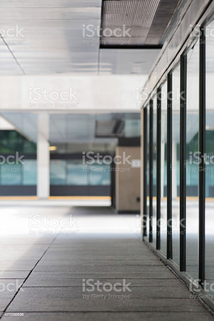 Urban office building sidewalk defocused vertical background stock photo