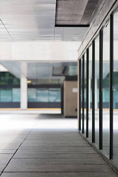 Urban office building sidewalk defocused vertical background stock photo