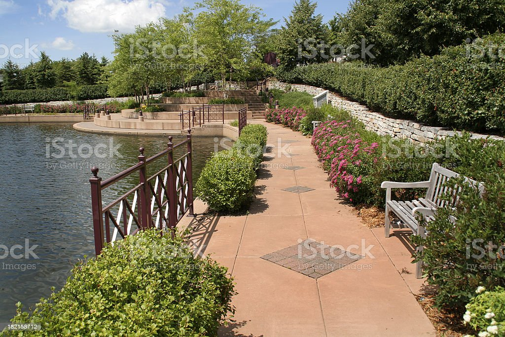 Urban Park with Walking Path, Landscaping by Lake in Spring stock photo