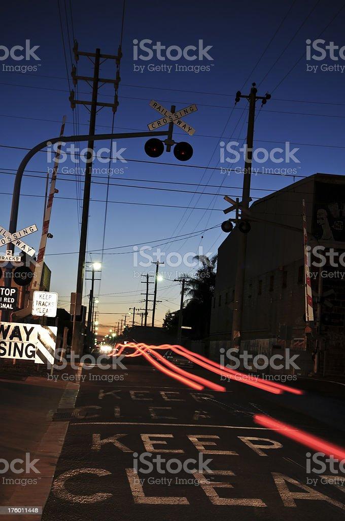 Urban Railway Crossing at Dusk stock photo