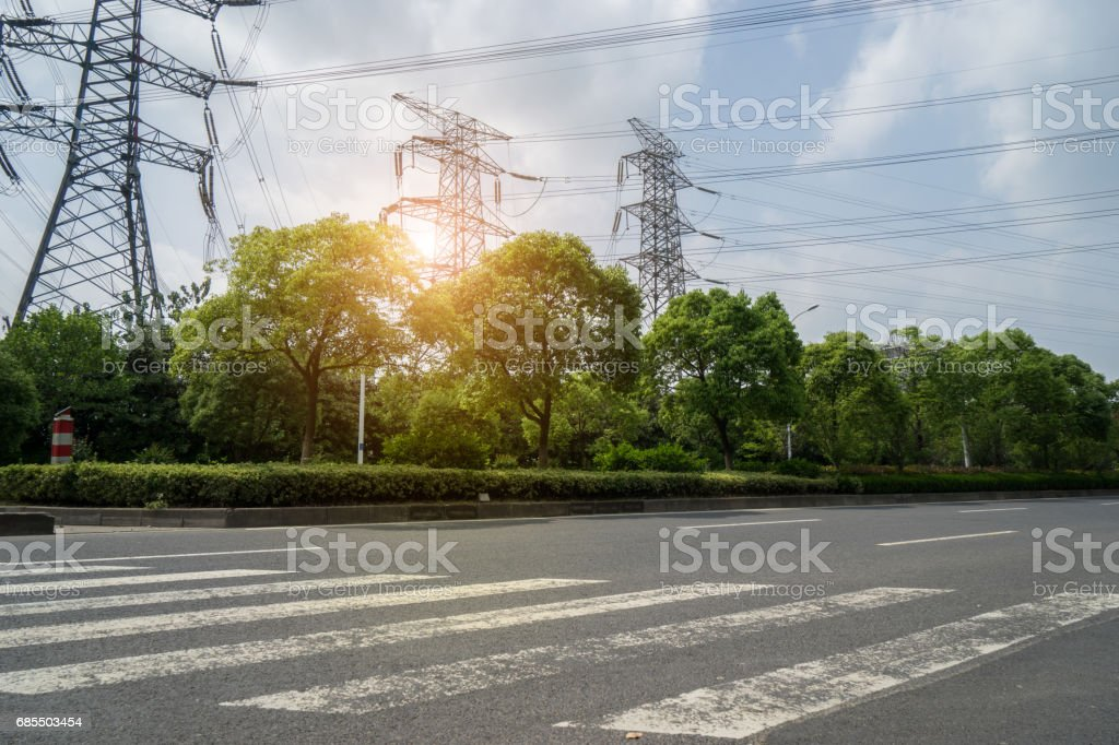 Urban road traffic and electric towers stock photo