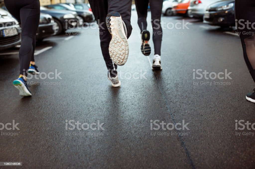 Urban runner jogging on the city street stock photo