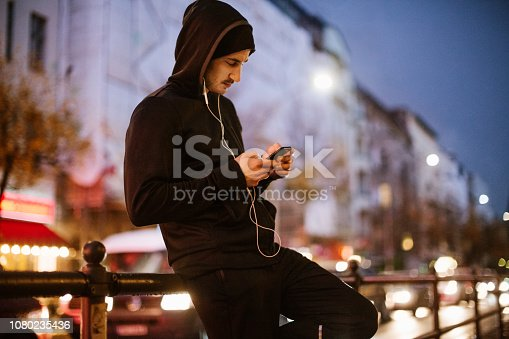 istock Urban runner relaxing after exercising 1080235436