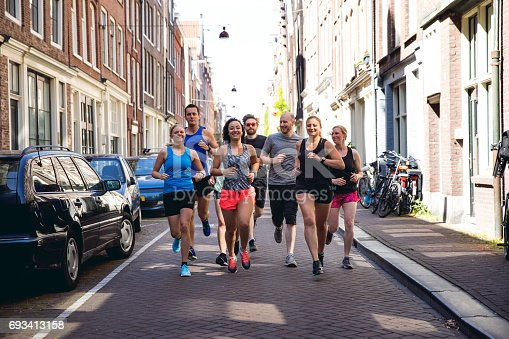 Urban runners crew training in the city in Amsterdam, Netherlands.