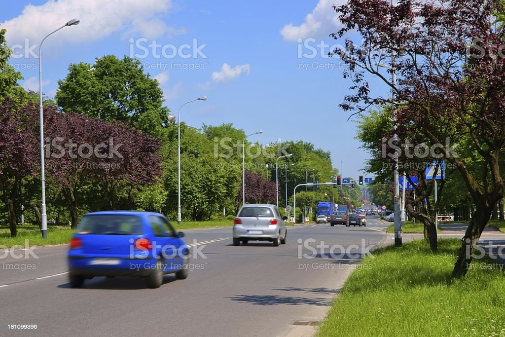 Urban scene, cars coming to a junction with traffic lights royalty-free stock photo