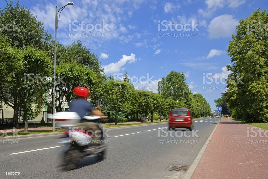 Urban scene, scooter and cars driving on the street royalty-free stock photo
