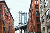urban scene with buildings and brooklyn bridge in new york city, usa