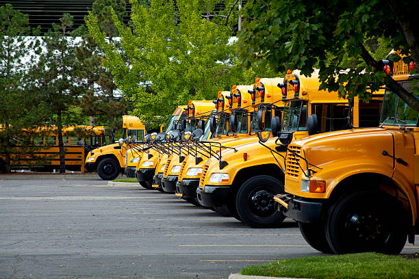 Urban School Bus Parking Lot stock photo