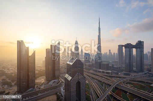 512697874 istock photo Urban skyline and cityscape at sunrise in Dubai UAE. 1202196747