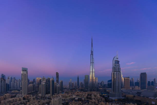 Urban skyline and cityscape at sunrise in Dubai UAE. stock photo