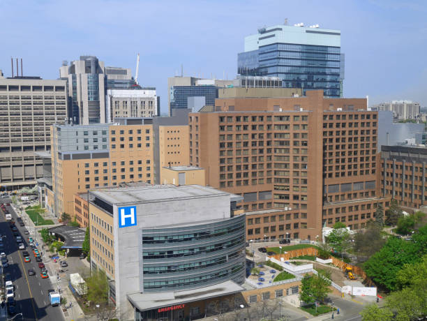 urban skyline with hospital and office buildings - hospital building stock photos and pictures