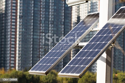 904490858istockphoto Urban solar power, low carbon and environmentally friendly city 1064136868