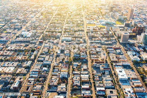 The grid pattern of the streets in the residential district near downtown Los Angeles, California from an altitude of about 1500 feet over the city shot near sunset facing westerly.