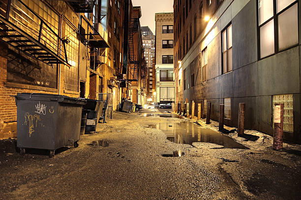 Urban Street at Night Dark wet alley in the City of Boston alley stock pictures, royalty-free photos & images