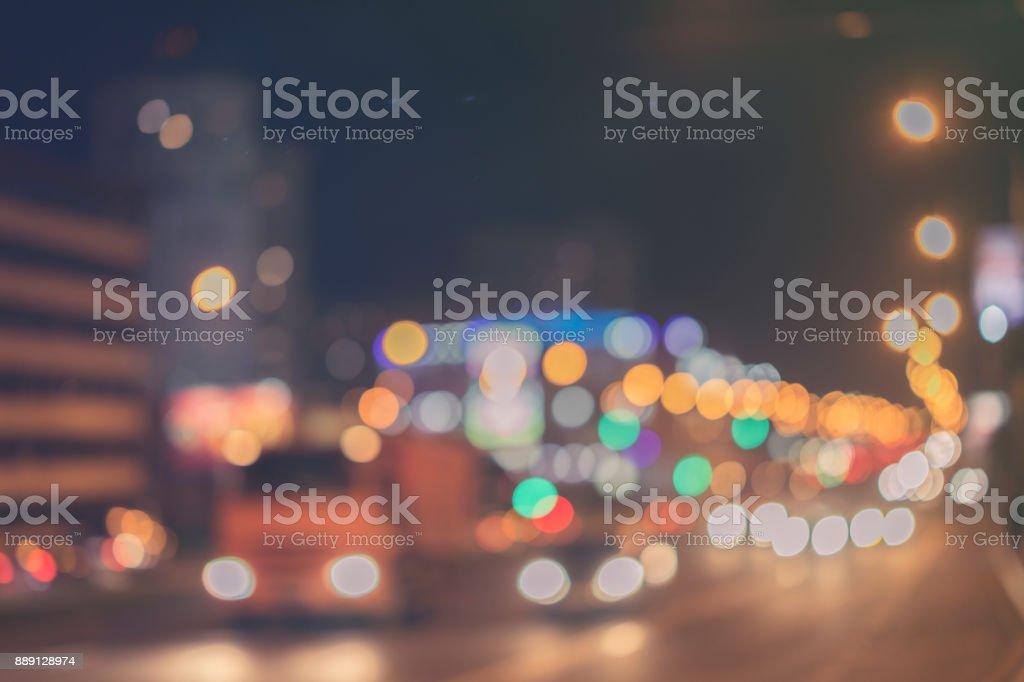 Urban street night traffic with bokeh lights, auto with brake lights,...
