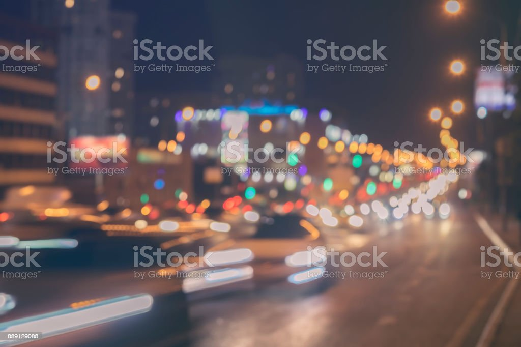 Urban street night traffic with bokeh lights. Blurred auto with brake...