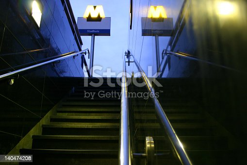 Underground station exit stadhuis Rotterdam. Staircase of a metro station downtown.