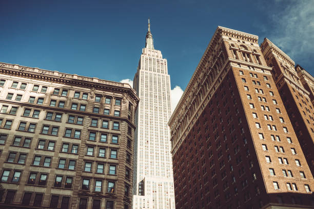 urban view of the empire state building urban view of the empire state building empire state building stock pictures, royalty-free photos & images