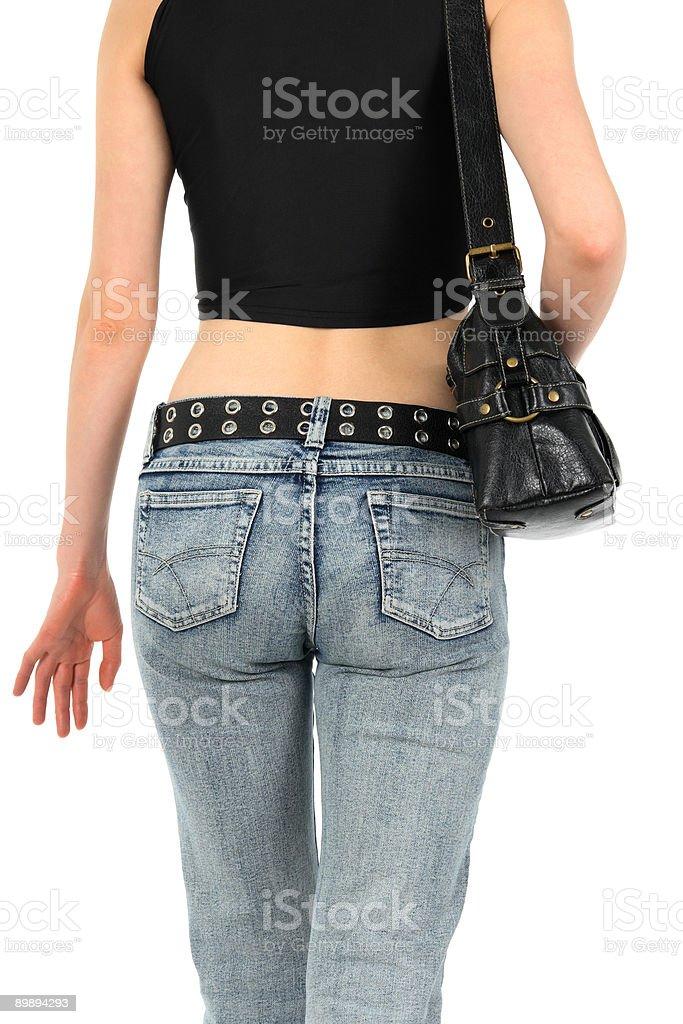Urban woman in jeans con handbag foto de stock libre de derechos