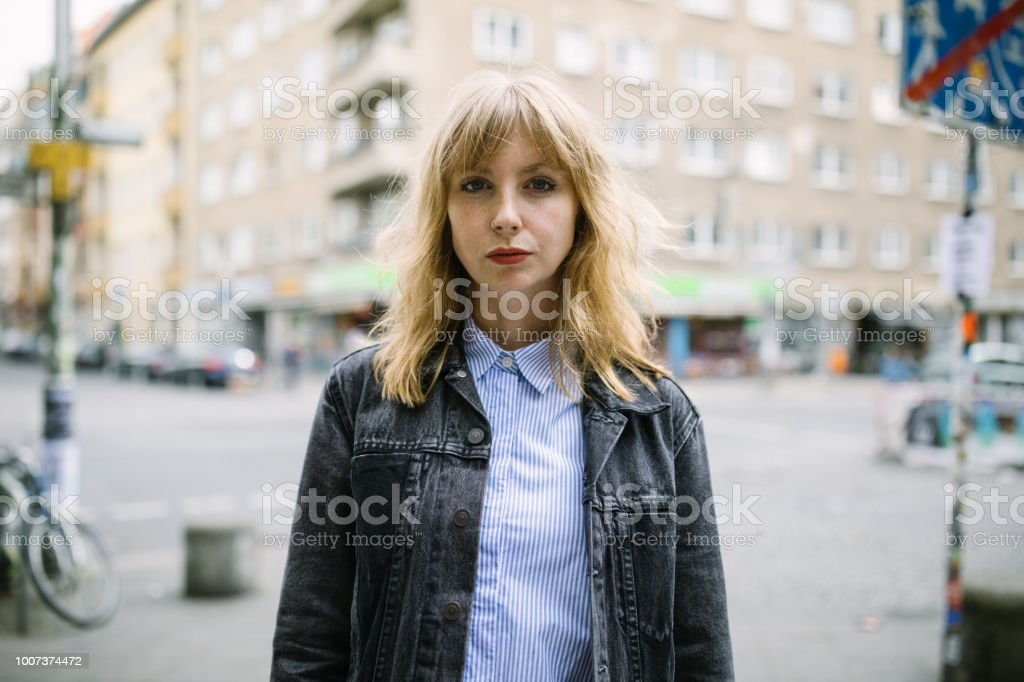 Urban woman standing outdoors in the city stock photo