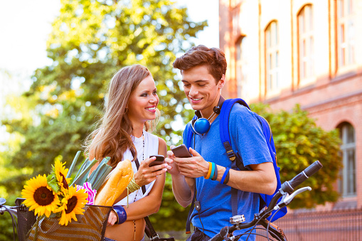 Urban Young People Using Smart Phones Stock Photo - Download Image Now
