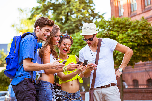 Urban Young Peoplewith Smart Phones Stock Photo - Download Image Now