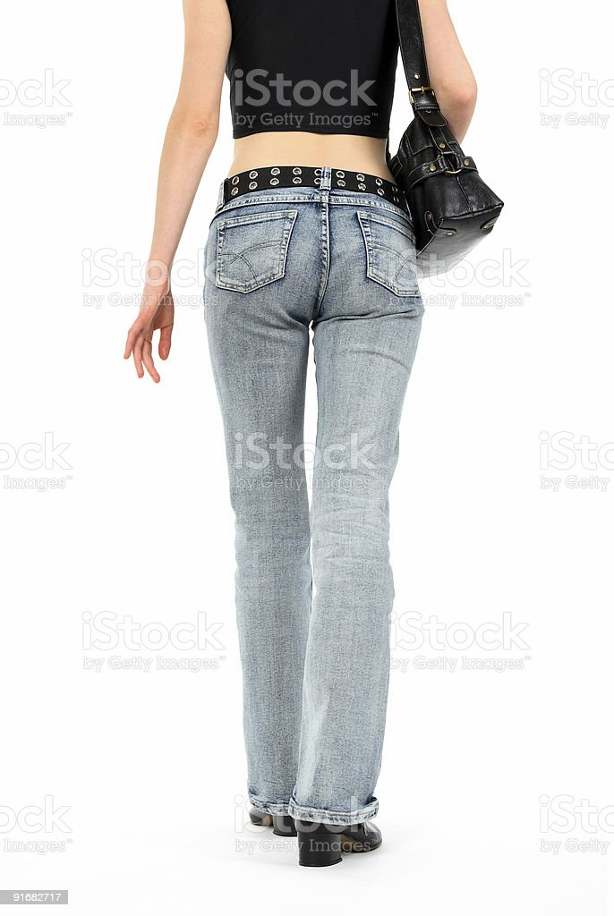 Urban young woman in jeans royalty-free stock photo