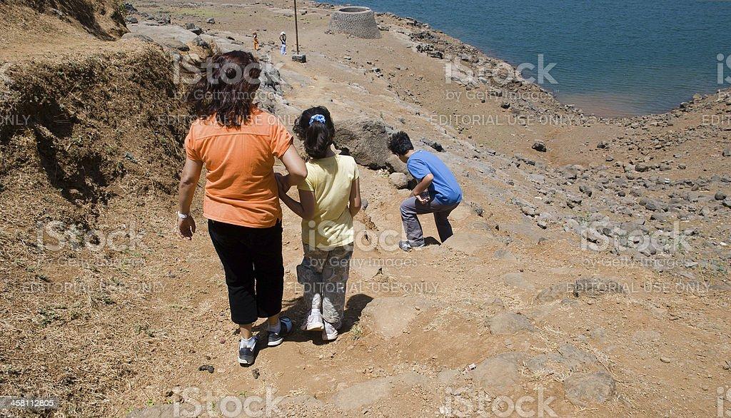 Urbanites gingerly picking their way in rural India stock photo