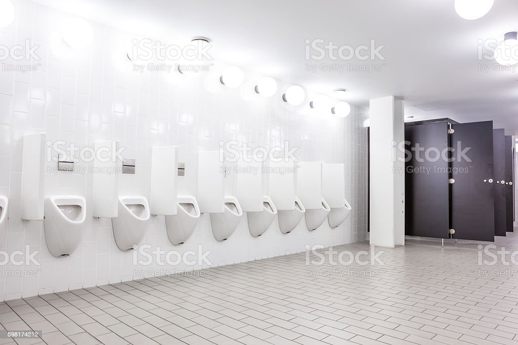 urinal and toilet doors stock photo