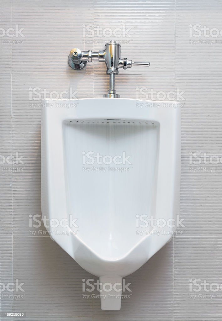 Urinal in male restroom stock photo