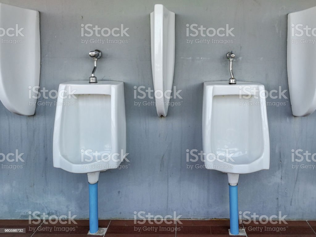 Urinals Are Lined Up On The Wall Toilet For Men Stock Photo & More ...