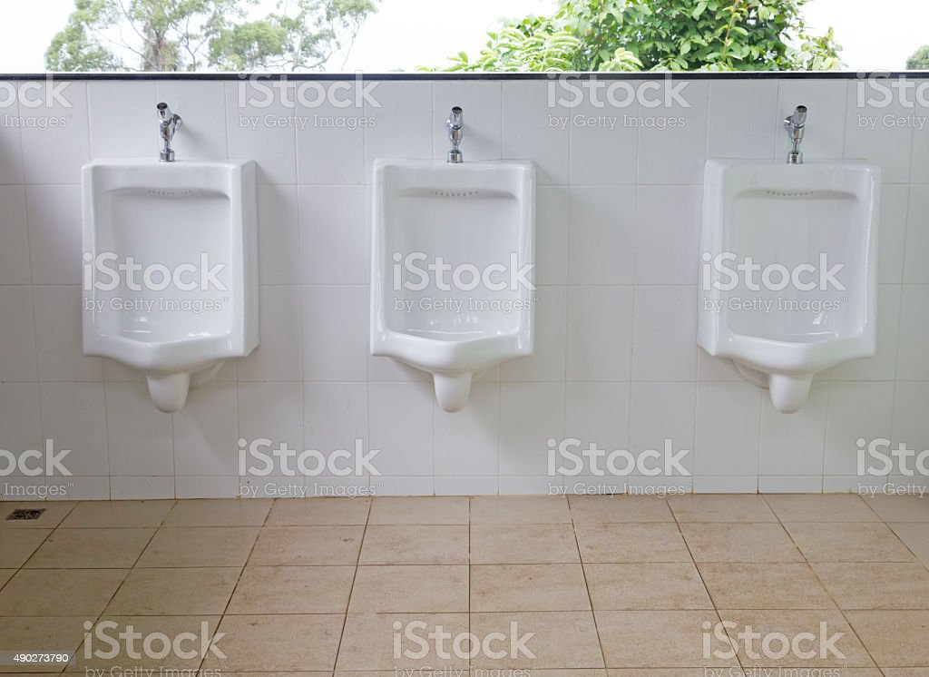 Urinals for men and boys in public toilet stock photo