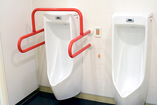 Urinals For The Disabled In Public Toilets Stock Photo - Download Image Now  - iStock