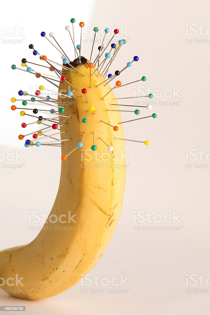 Urinary problems: pins and banana stock photo