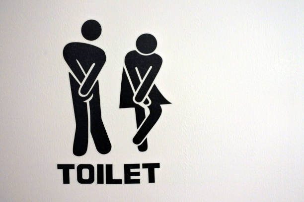 Urinary Urgency Toilet Sign for men and women stock photo