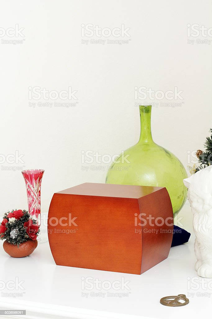 Urn on a Mantle with Memories royalty-free stock photo