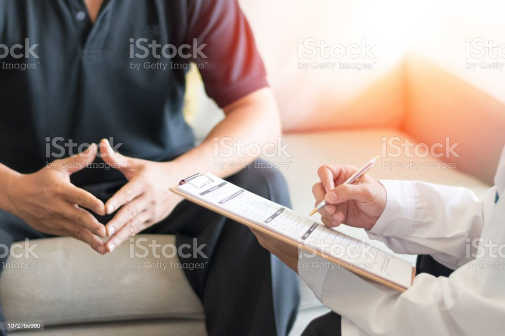 Urologist Doctor giving consult for prostate problems to patient. Urologic oncologists specialize in treating cancer of the urinary tract and male reproductive organs. Mens health problem concept. Urologist Doctor giving consult for prostate problems to patient. Urologic oncologists specialize in treating cancer of the urinary tract and male reproductive organs. Mens health problem concept. Adult Stock Photo
