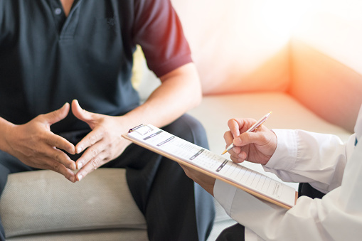 istock Urologist Doctor giving consult for prostate problems to patient. Urologic oncologists specialize in treating cancer of the urinary tract and male reproductive organs. Mens health problem concept. 1072755960