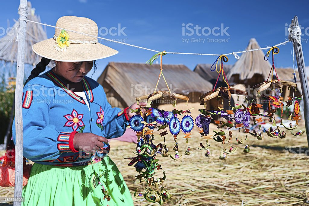 Uros woman selling souvenirs on floating island royalty-free stock photo