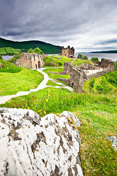 Urquhart Castle Urquhart Castle On the banks of Loch Ness in the Highlands of Scotland. inverness scotland stock pictures, royalty-free photos & images
