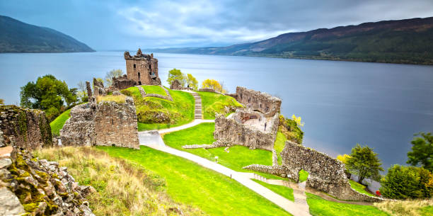 Urquhart Castle with Dark Cloud Sky The world famous Urquhart Castle on a Rainy Day. inverness scotland stock pictures, royalty-free photos & images