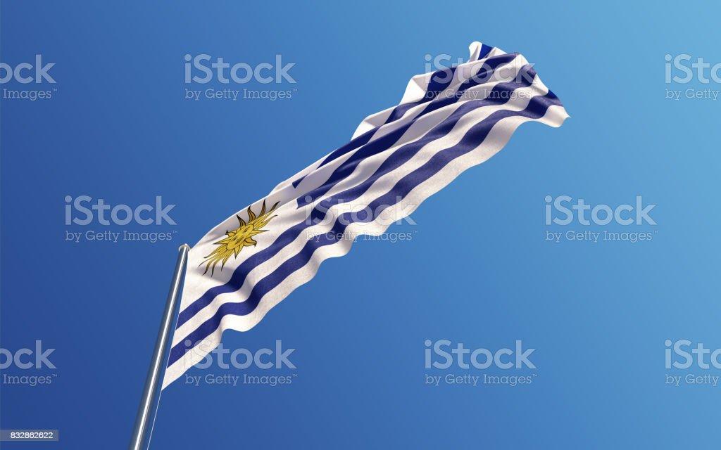 Uruguayos bandera ondeando con el viento en el cielo azul - foto de stock