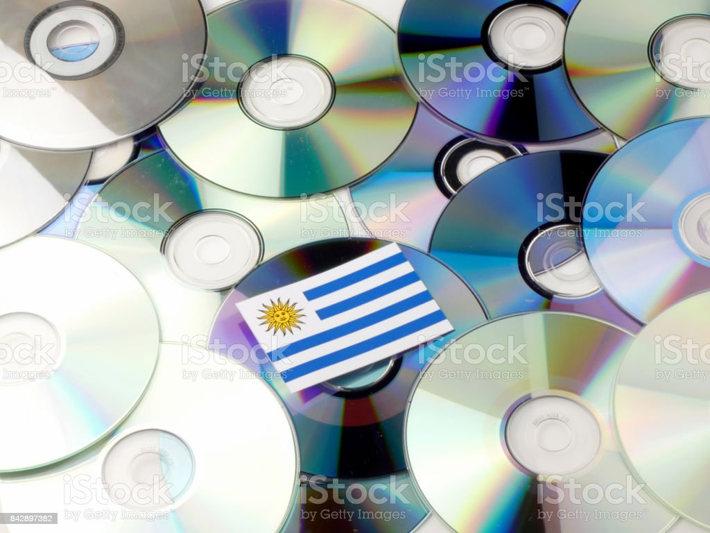 Uruguay flag on top of CD and DVD pile isolated on white stock photo
