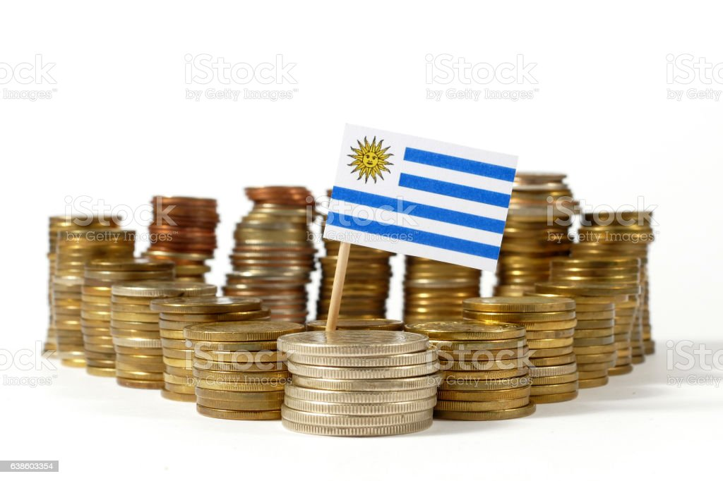 Uruguay flag waving with stack of money coins stock photo