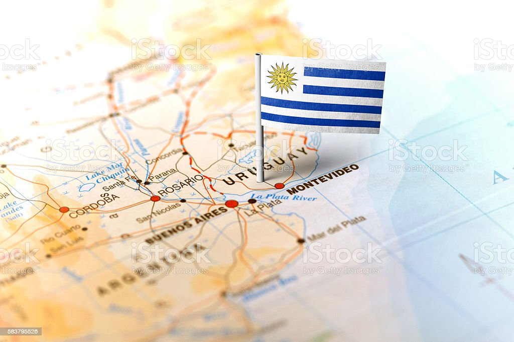 Uruguay pinned on the map with flag stock photo