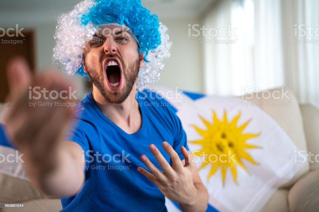 Uruguayaanse fan vieren thuis - Royalty-free Alleen mannen Stockfoto