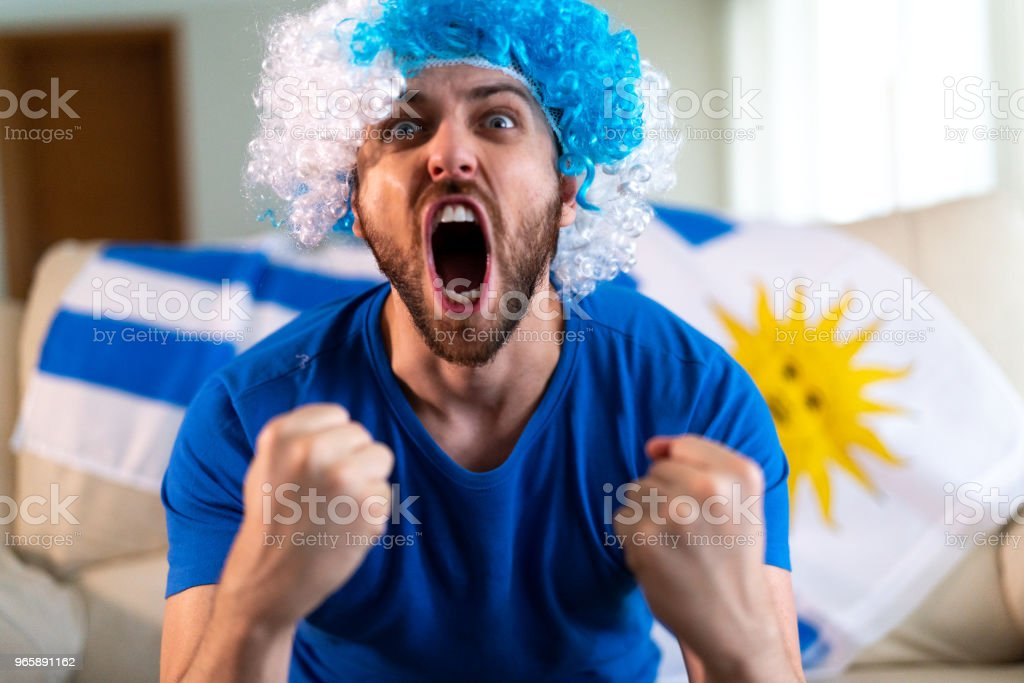 Uruguayan fan celebrating at home - Royalty-free Adult Stock Photo